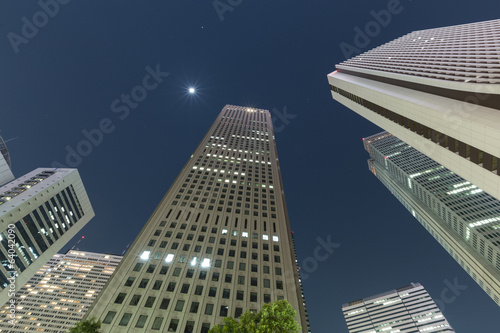 Low angle shot of office buildings at night, Shinjuku, Tokyo