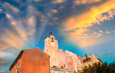 Sunset sky above beautiful red homes of Roussillon, France