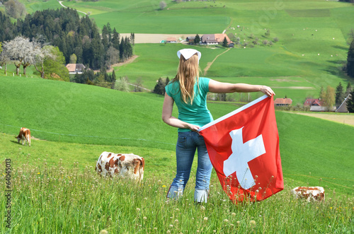 Girl holding the Swiss flag. Emmental, Switzerland