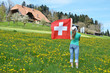 Girl with the Swiss flag. Emmental, Switzerland