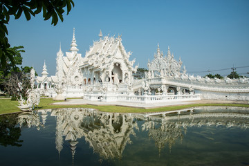 Grand white church and reflection in the water, Wat Rong Khun Ch