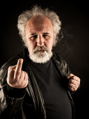 Grumpy man showing middle finger