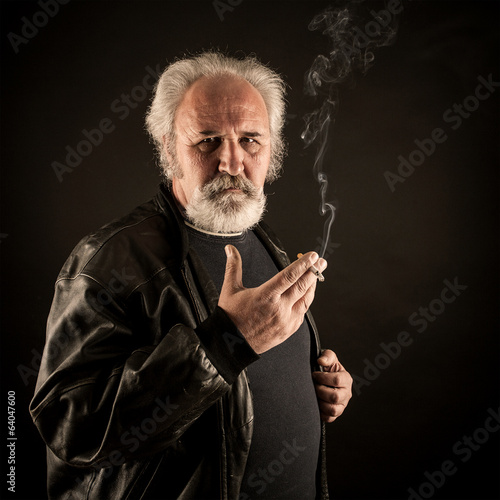 Grumpy man with cigarette