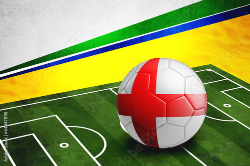 Soccer ball with England flag on pitch