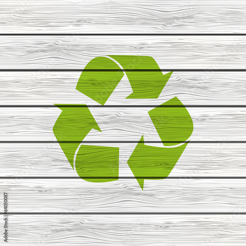 Recycling symbol on wooden background