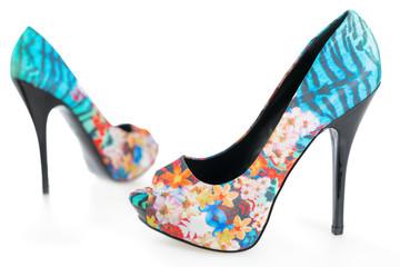 Multicolored stiletto shoes on white