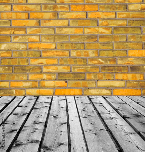 Wooden boards and orange brick wall