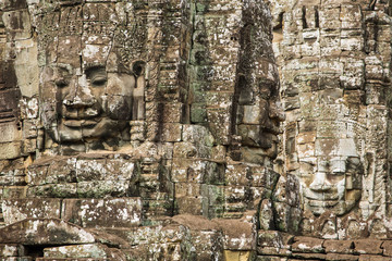 Stone faces on the towers of ancient Bayon Temple in Angkor Thom