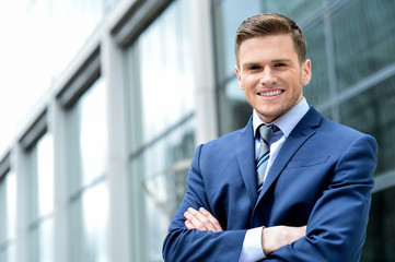 Young businessman smiling in a office outdoor