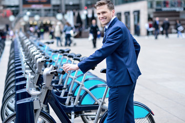Young businessman with a bicycle