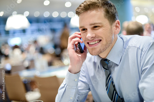 Young executive talking on the phone