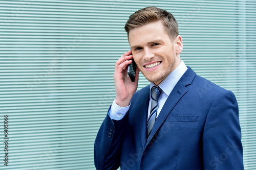Young businessman speaking on his cell phone