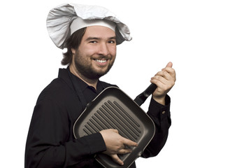 The Chef Playing on Fry Pan like on Guitar isolated on white