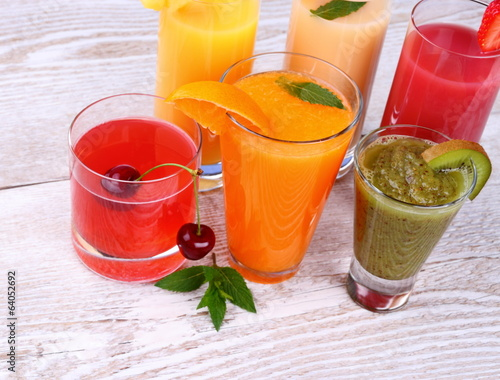 Fruity drinks juice from cherry, kiwi, tangerine