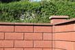 Leinwandbild Motiv neue rote Gartenmauer
