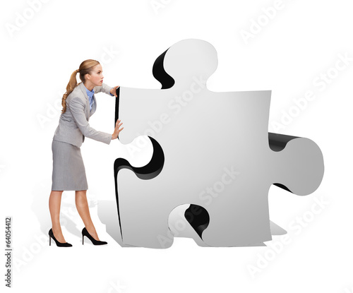 busy businesswoman pushing puzzle piece