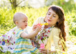 mother and kid girl having fun outdoors