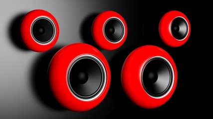 Red round speakers on on dark wall