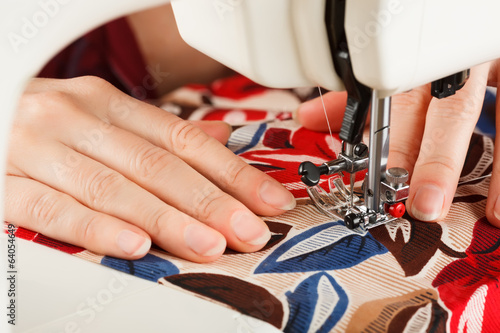 doing some sewing clothings on a sewing typewriter