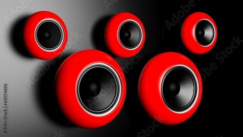 altavoces-redondos-rojos-en-la-pared-oscura