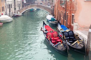 Two gondola in Venice near pier