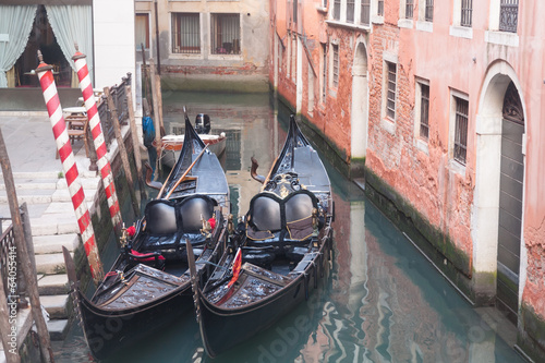 Two gondola in Venice near pier
