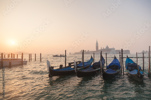 Poster Gondolas Venetian gondolas at sunrise in venice