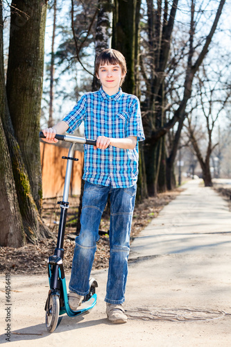 Boy with kick scooter