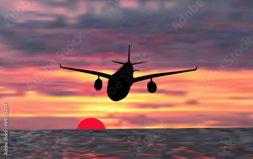 plane at sunset above sea