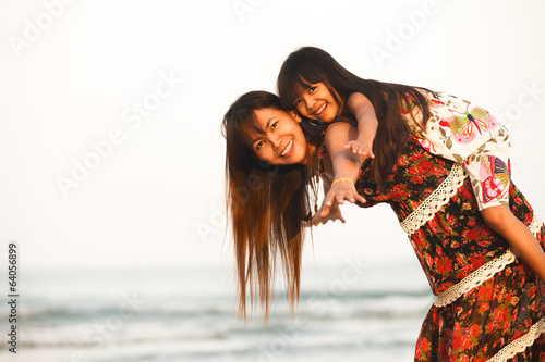 Happy mother holding her daughter