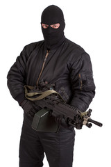 terrorist with machine gun isolated