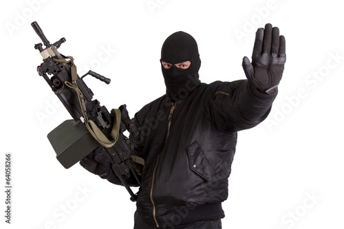 terrorist with machine gun isolated