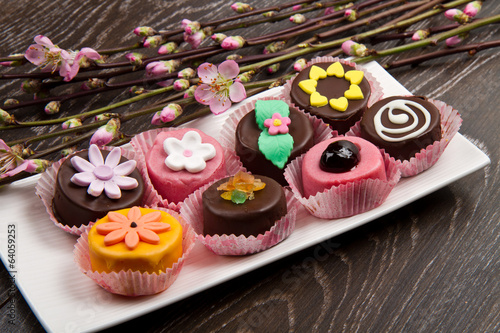 variety of cassate sicily dessert with spring flower on wood