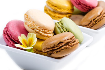 white bowl with colored macaroons
