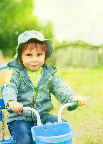 Kid on tricycle.