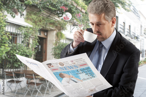 Businessman reading a newspaper