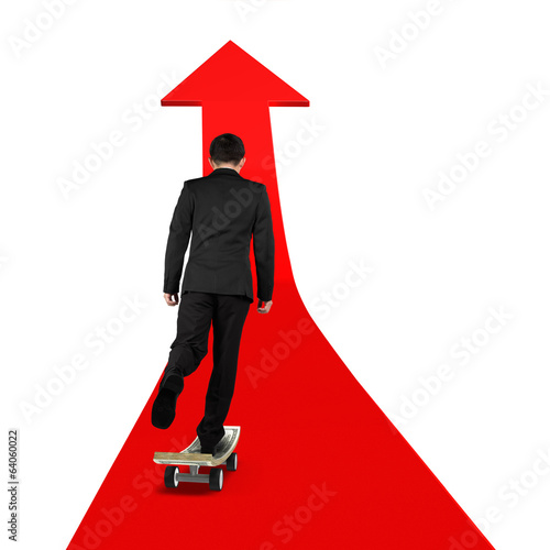 businessman skateboarding on red arrow