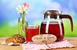 Tasty herbal tea and cookies on wooden table