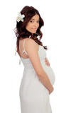 Lovely pregnant woman with a beautiful dress