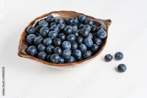 Blueberry in bowl on white