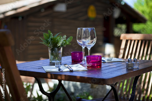 Table set on the terrace of a Frenc restaurant