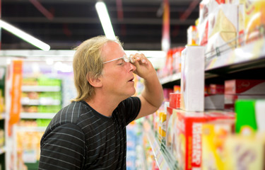 Man chooses products at the supermarket