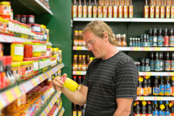 man buy corn in the supermarket