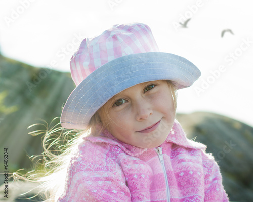 Cheerful girl in hat