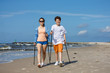 Nordic walking - young people working out on beach