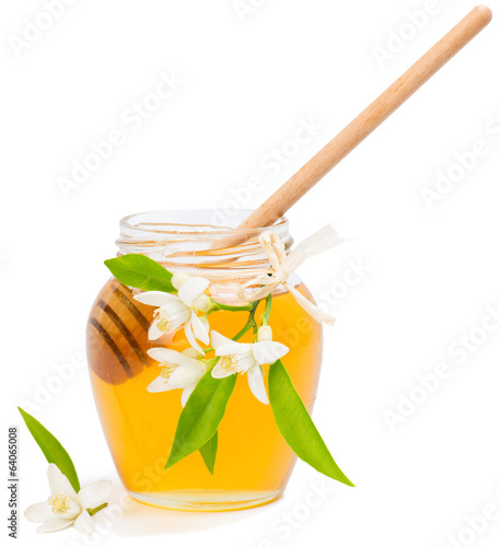 jar with honey and flowers of orange