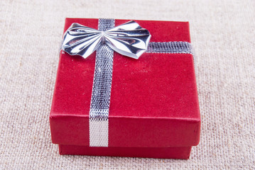 red gift box on canvas