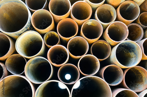 Rusty old pipes stacked up with natural light