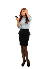 Angry business woman pulling her hair and yelling at her phone