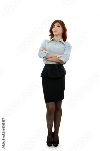 Successful business woman posing with her arms folded